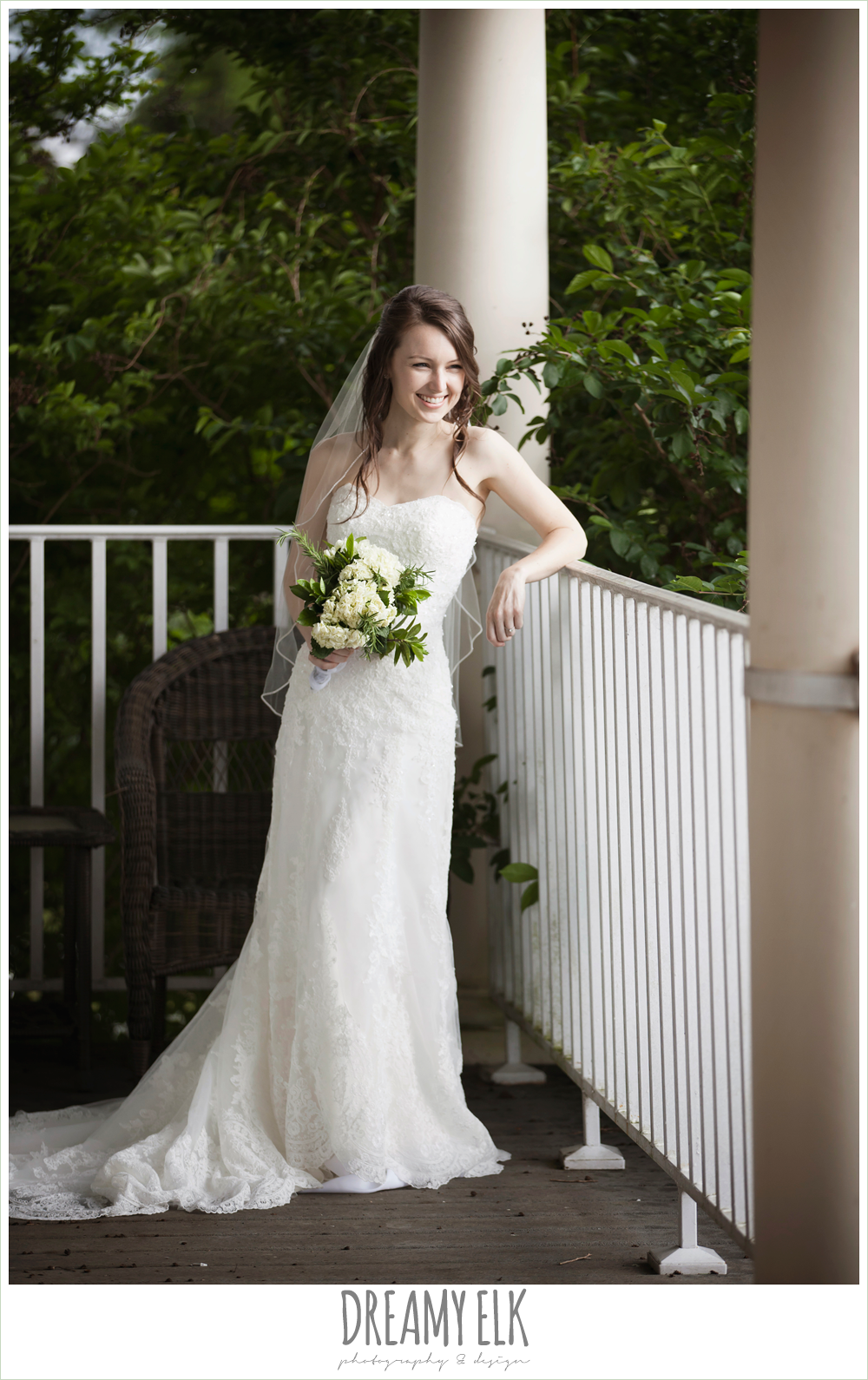lace sweetheart strapless wedding dress, outdoor rainy day bridal photo on a porch {dreamy elk photography and design}