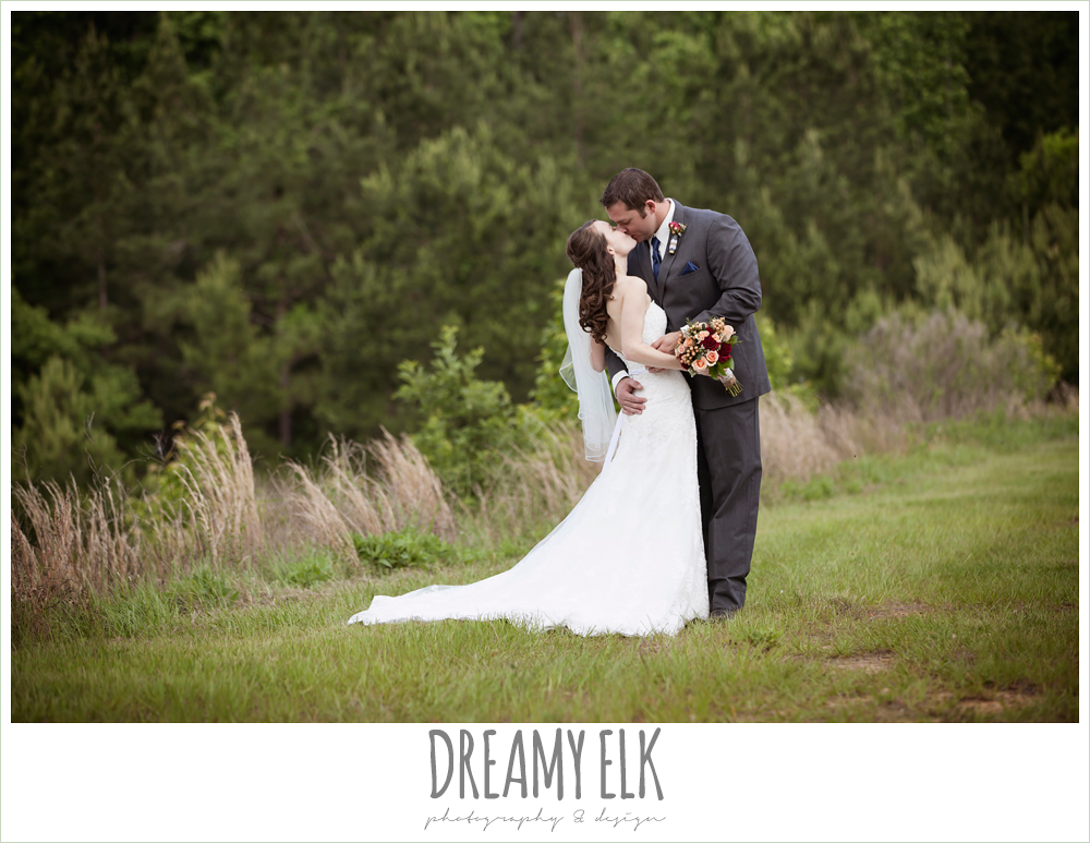 bride and groom kissing, strapless lace wedding dress, gray suit and navy tie, pine lake ranch, photo {dreamy elk photography and design}