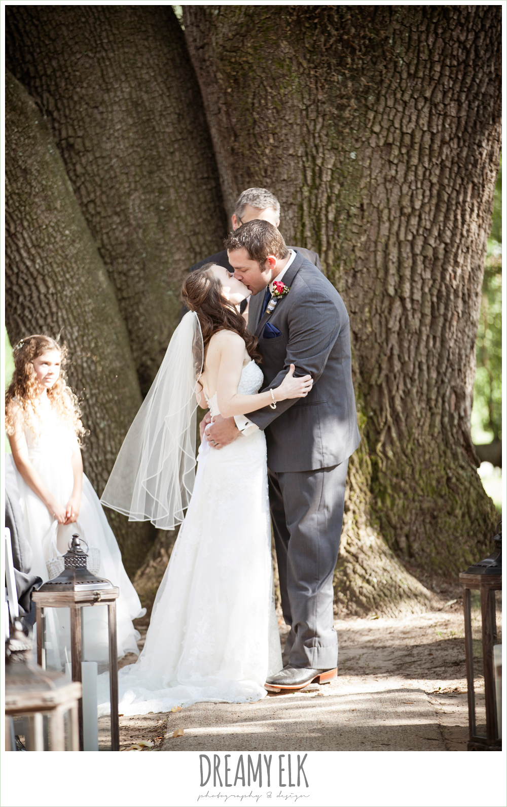bride and groom kissing during ceremony, wedding under an oak tree, pine lake ranch, photo {dreamy elk photography and design}