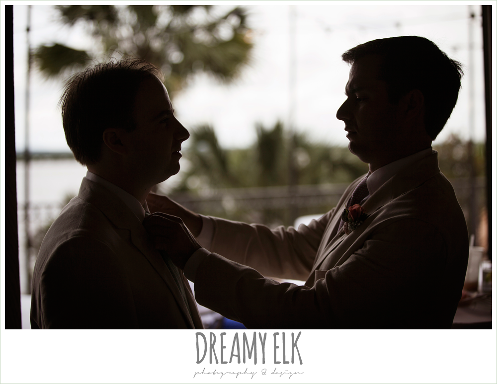 groomsmen tying groom's tie, nautical theme wedding, horseshoe bay resort, photo {dreamy elk photography and design}