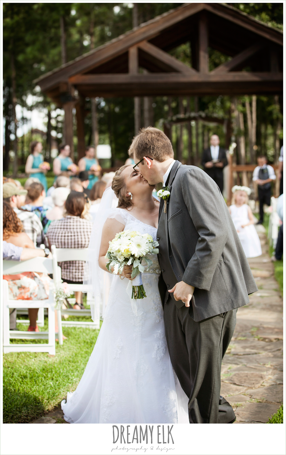 bride and groom kissing during the ceremony, amber springs summer wedding photo {dreamy elk photography and design}