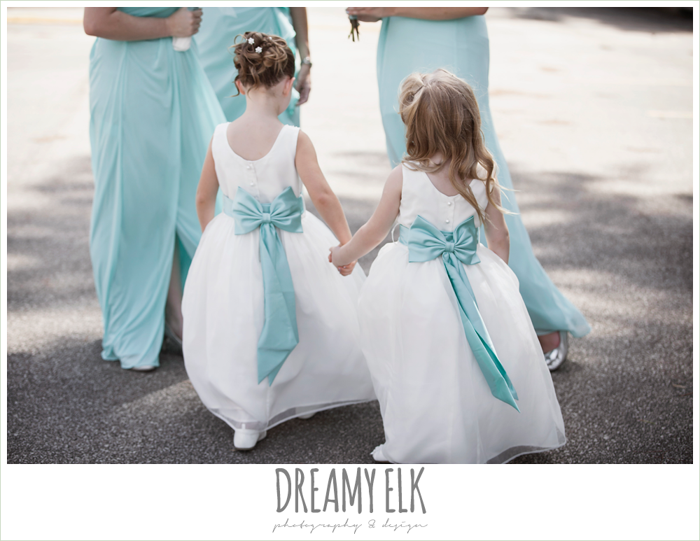 flower girls holding hands, white dress with blue sash, church wedding, summer wedding photo {dreamy elk photography and design}