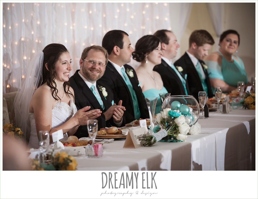 bride and groom sitting at head table, indoor wedding reception, magnolia lake, summer wedding photo {dreamy elk photography and design}