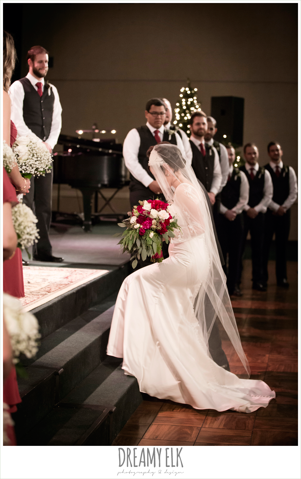 bride and groom during wedding ceremony, winter december church wedding photo {dreamy elk photography and design}