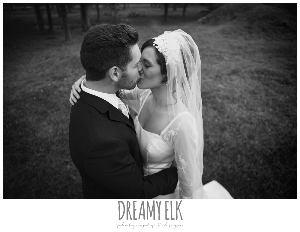 bride and groom kissing, winter december church wedding photo {dreamy elk photography and design}