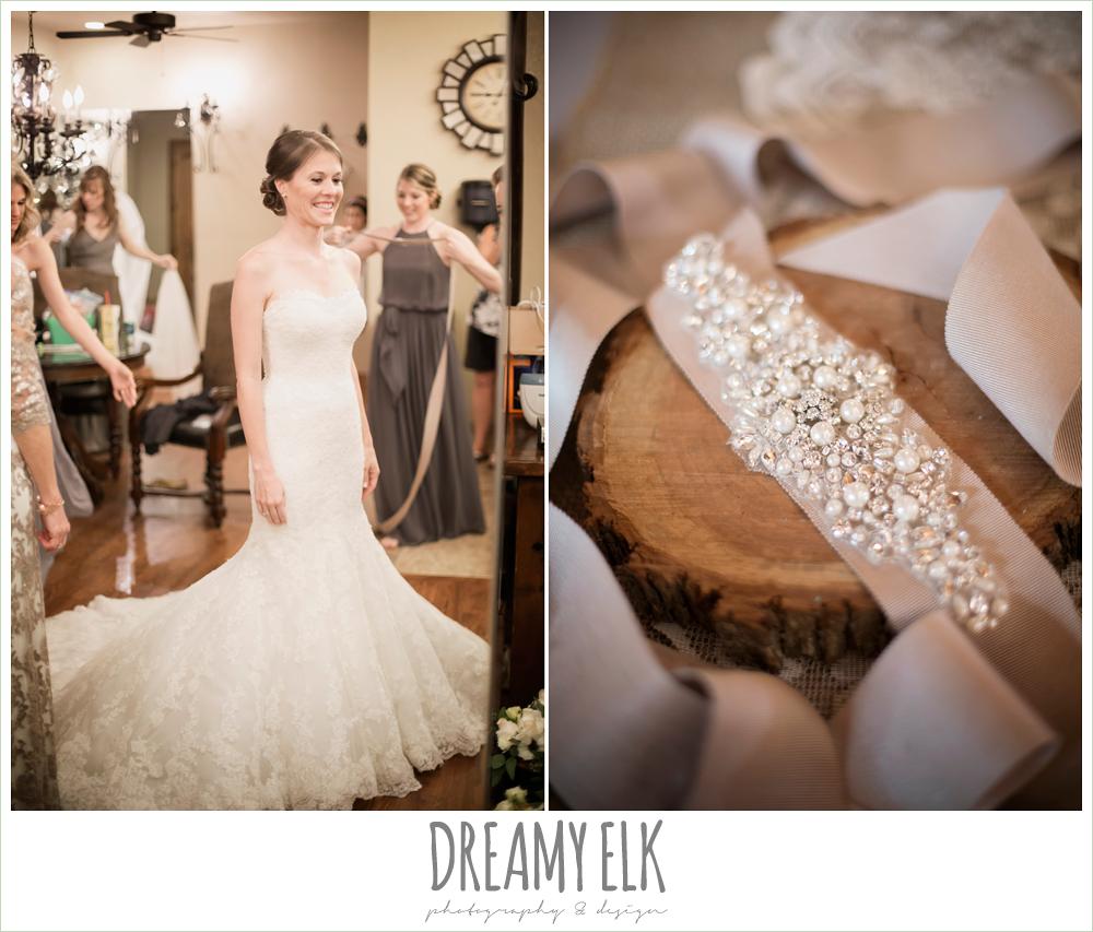 strapless lace pronovias wedding dress, rhinestone blush belt, bride getting dressed,