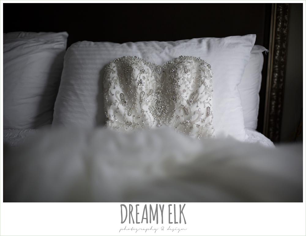 beaded sweetheart wedding dress lying on bed {dreamy elk photography}