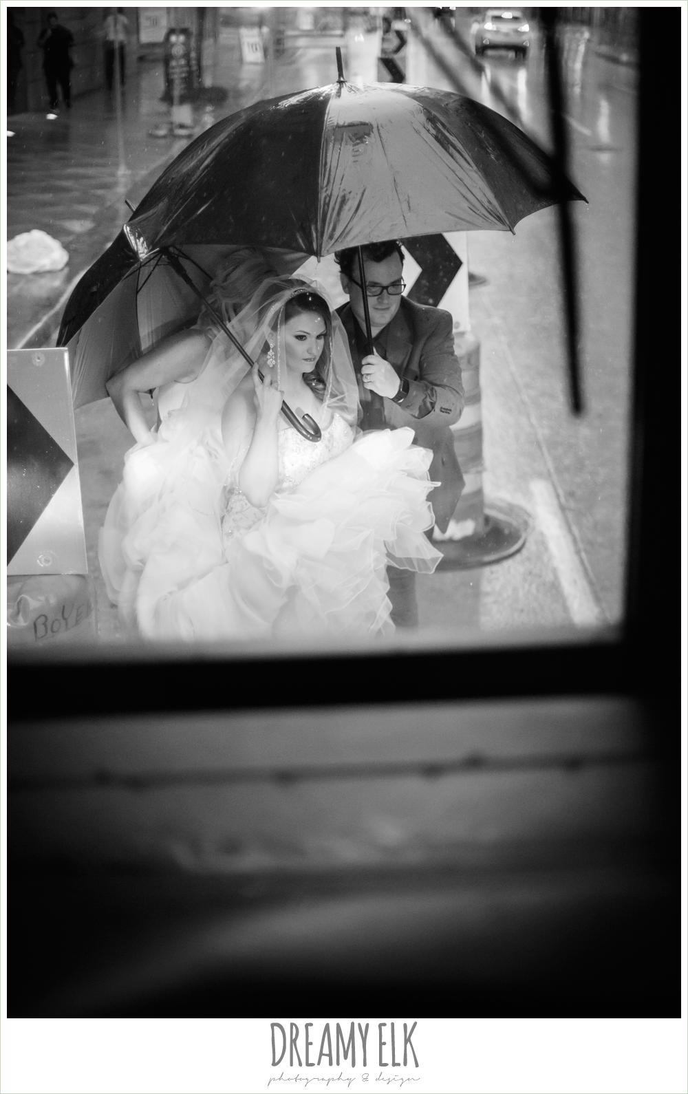 rainy wedding day, bride under an umbrella, spring wedding, magnolia hotel, houston, texas {dreamy elk photography and design}
