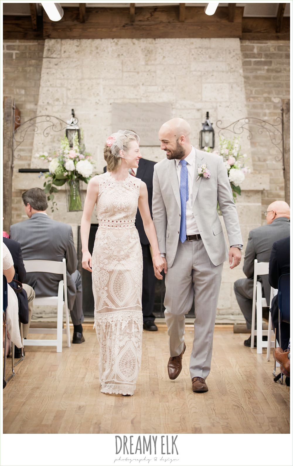 indoor wedding ceremony, bride and groom walking down aisle, spring wedding, austin, texas {dreamy elk photography and design}