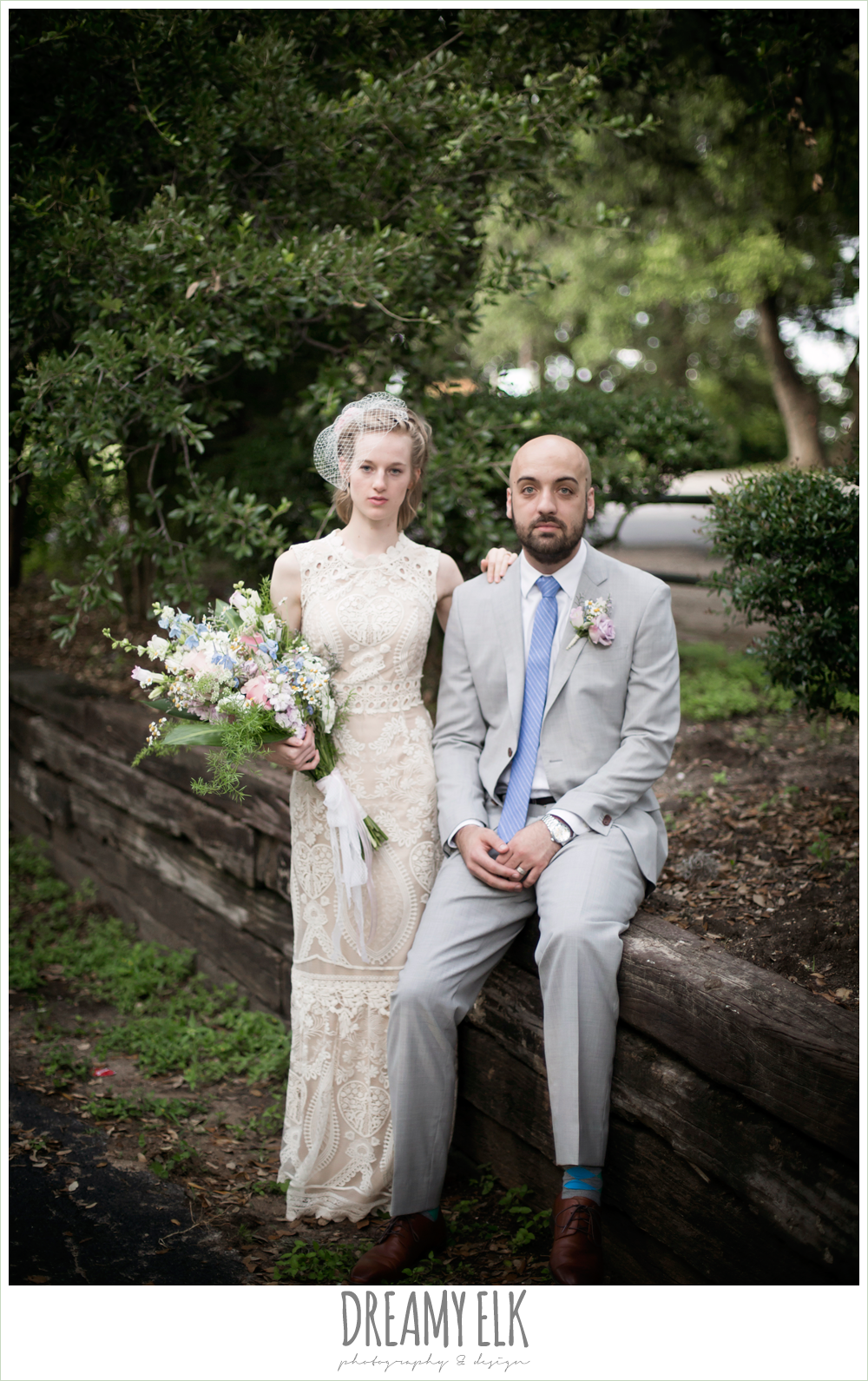 outdoor bride and groom portraits, bhldn ivory embroidered wedding dress, gray suit with blue tie, birdcage veil, pageant wildflower bouquet, spring wedding, hancock community center hyde park, austin, texas {dreamy elk photography and design}