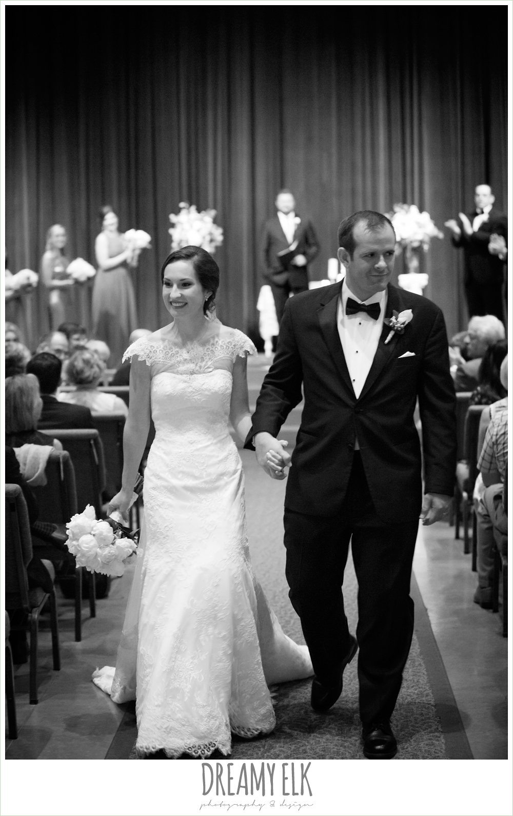 groom, classic tuxedo, white boutonniere, bride, lace wedding dress with lace sleeves, lace trimmed veil, bride and groom walking down aisle, indoor wedding ceremony, silver sequin wedding, fourth of july wedding photo {dreamy elk photography and design}f