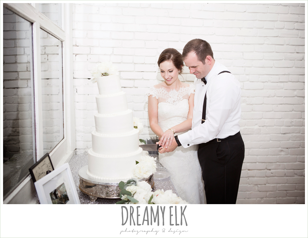 bride and groom cutting the cake, five tier white wedding cake, indoor wedding reception, one eleven east, silver sequin wedding, fourth of july wedding photo {dreamy elk photography and design}