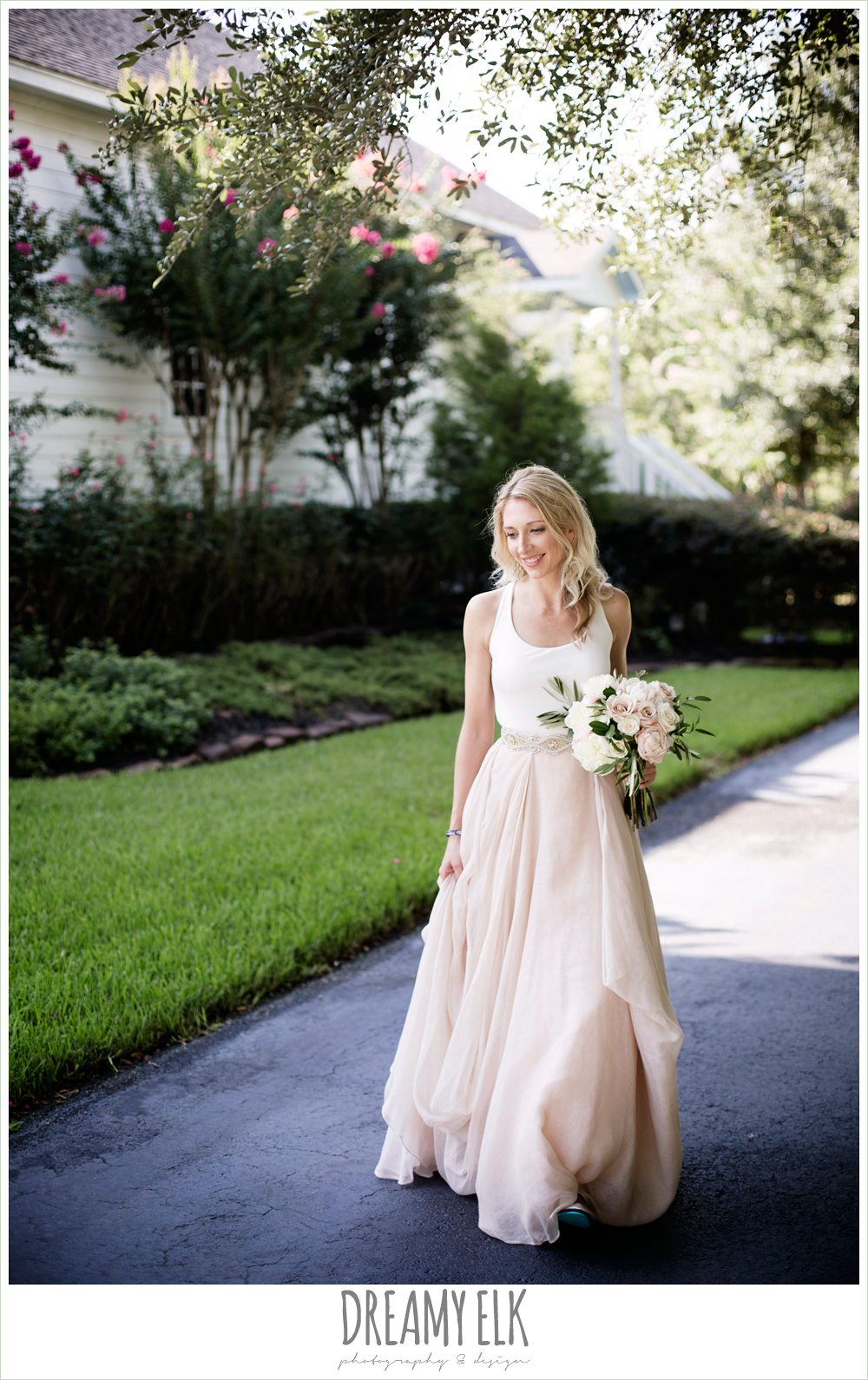 outdoor bridal photo, bride walking, southern protocol bridal boutique, tieks, haute bride belt, carol hannah kensington halter and blush skirt,