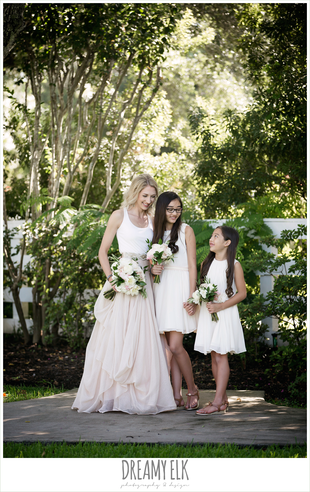 outdoor bridal party photo, bride and bridesmaids, jcrew girls dresses, southern protocol bridal boutique, carol hannah kensington halter and blush skirt,
