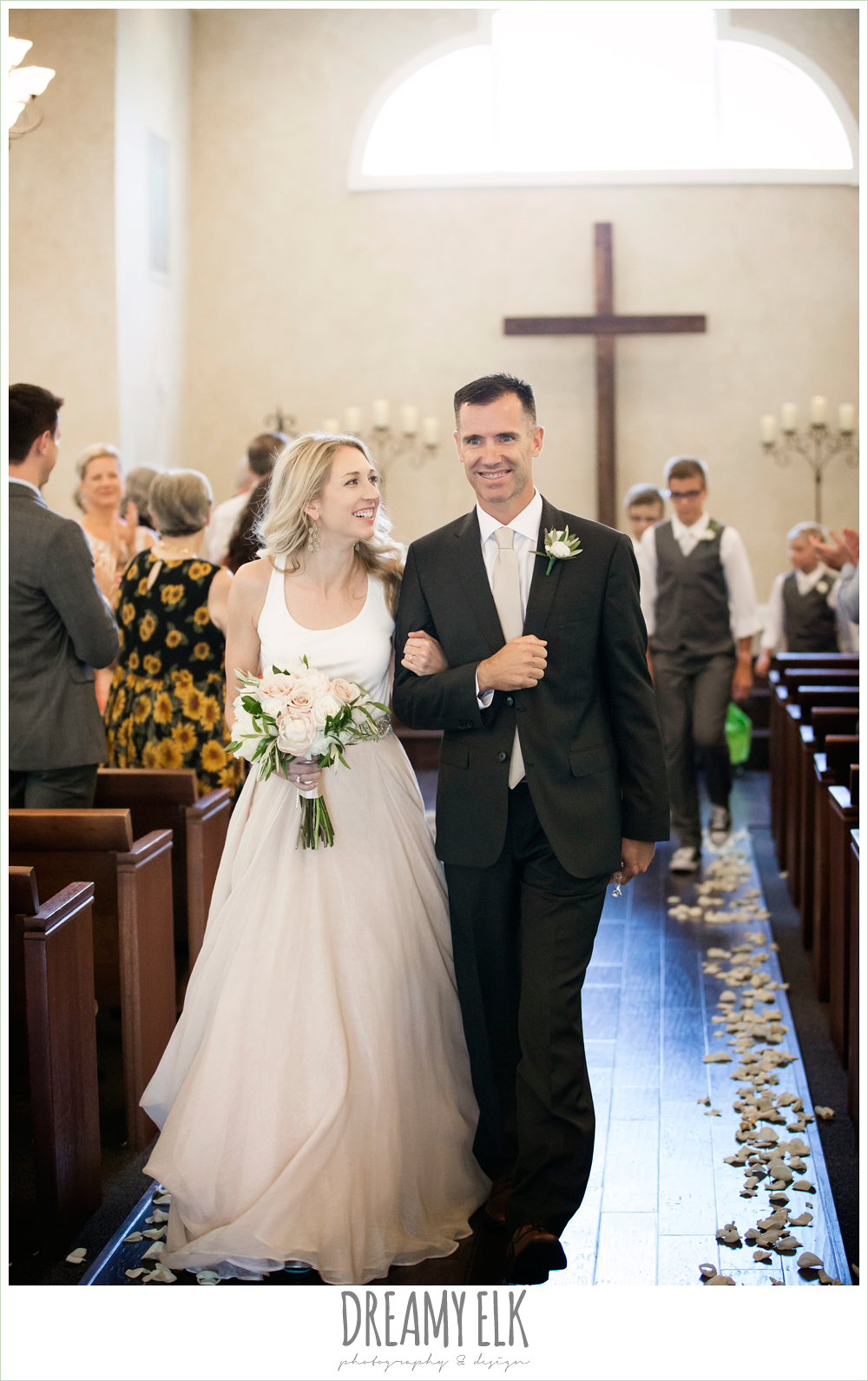 bride and groom walking down the aisle, hugo boss groom's suit, carol hannah kensington halter and blush skirt, july summer morning wedding, ashelynn manor, magnolia, texas {dreamy elk photography and design} photo