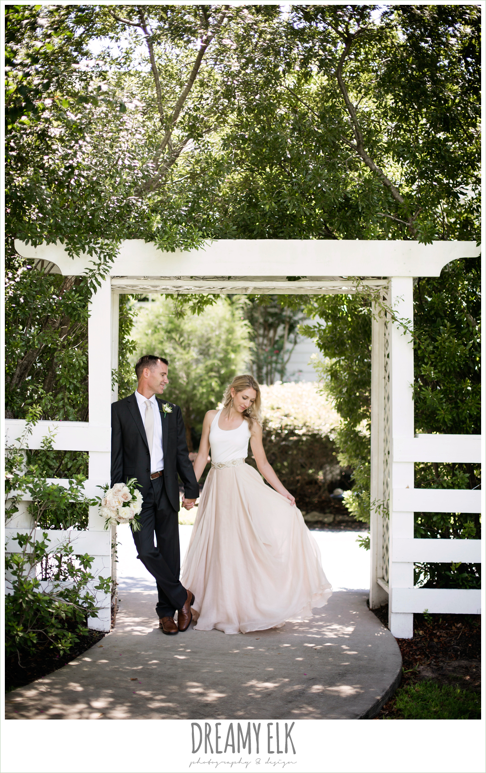 outdoor bride and groom photo, hugo boss groom's suit, southern protocol bridal boutique, haute bride belt, carol hannah kensington halter and blush skirt,