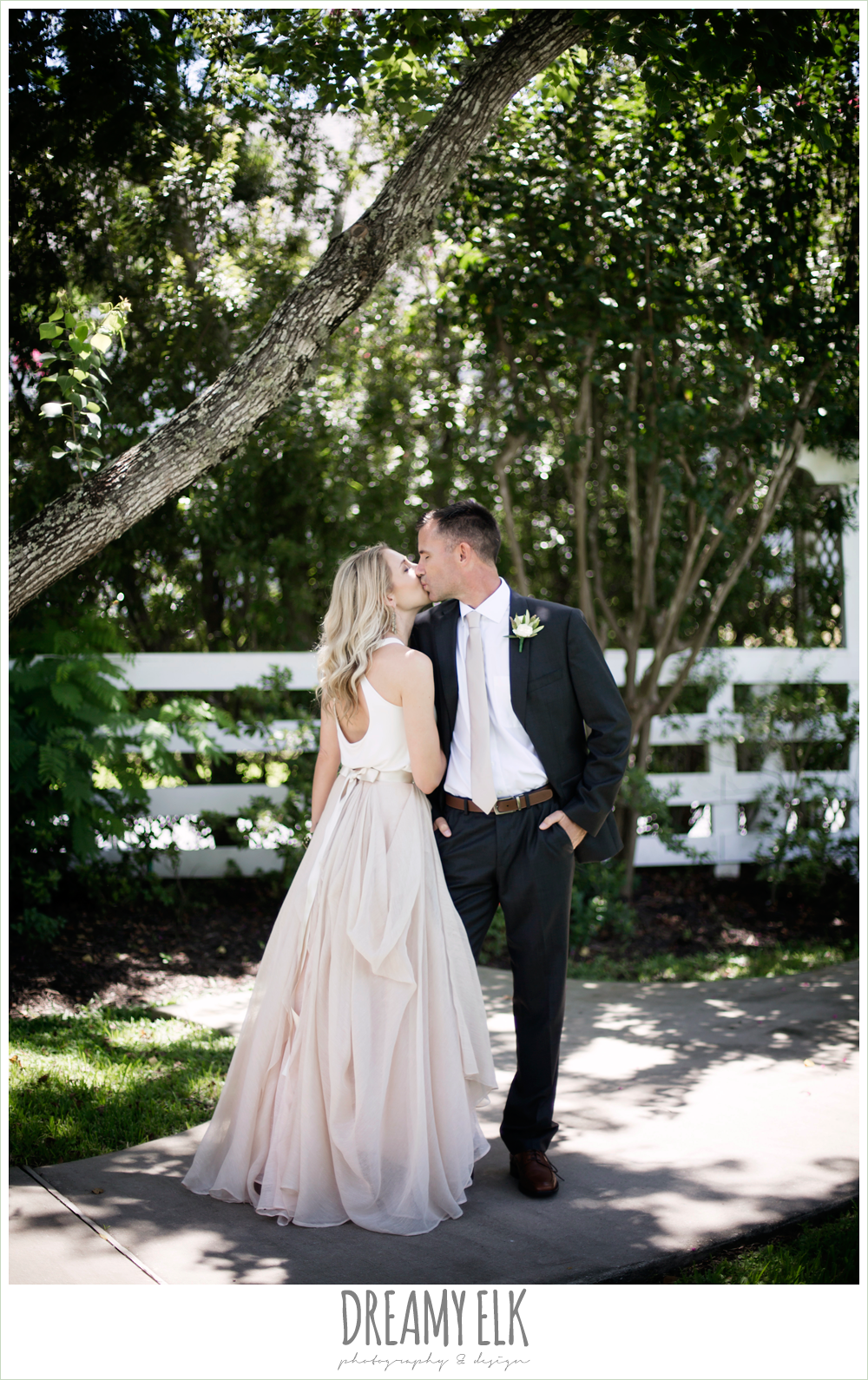 outdoor bride and groom photo, hugo boss groom's suit, southern protocol bridal boutique, carol hannah kensington halter and blush skirt,