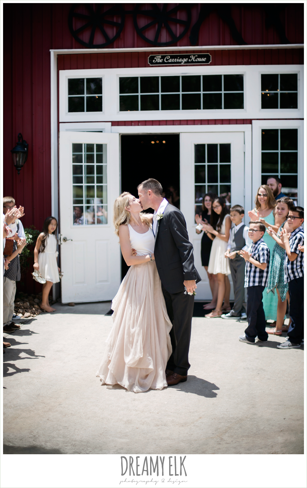 carol hannah kensington halter and blush skirt, bride and groom kissing while leaving wedding reception, july summer morning wedding, ashelynn manor, magnolia, texas {dreamy elk photography and design} photo