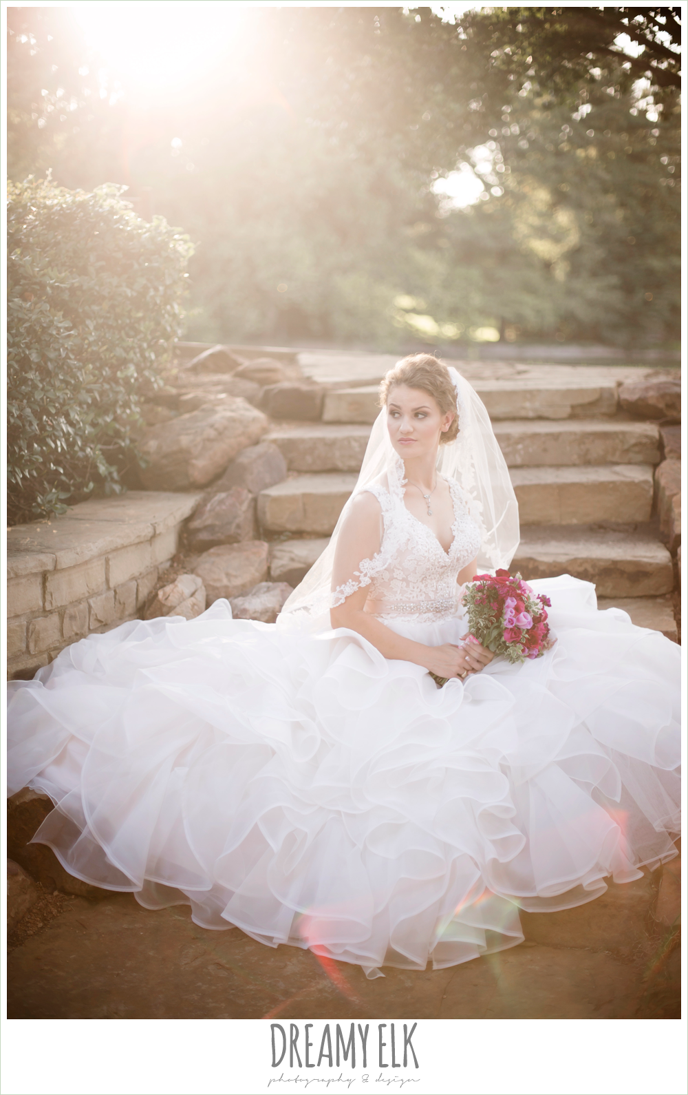 sunflare, outdoor summer bridal photo in the woods, lace bodice wedding dress with ruffles, blush wedding dress, curly hair updo, lace wedding veil, pink wedding bouquet, dallas, texas, austin wedding photographer {dreamy elk photography and design}