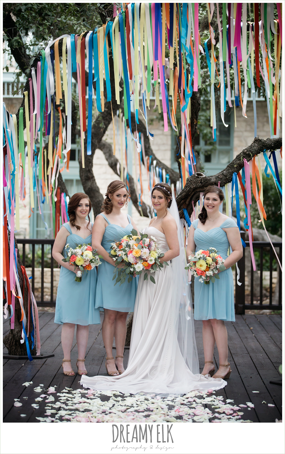 colorful streamers in trees ceremony decorations, Plans n' Petals wedding bouquet, bill levkoff bridesmaid dress in glacier blue, sweetheart strapless justin alexander wedding dress in sand color, colorful outdoor sunday morning brunch wedding, hyatt hill country club, san antonio wedding photo {dreamy elk photography and design}