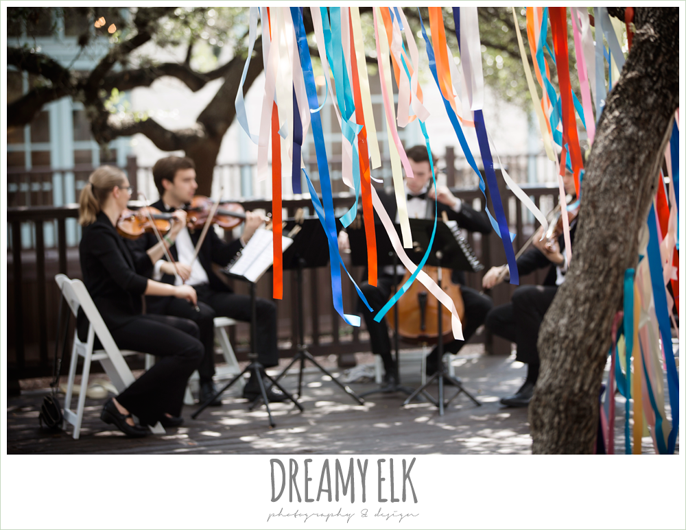 colorful streamers in trees ceremony decorations, divisi strings stringed quartet, ceremony music, stringed quartet, colorful outdoor sunday morning brunch wedding, hyatt hill country club, san antonio wedding photo {dreamy elk photography and design}