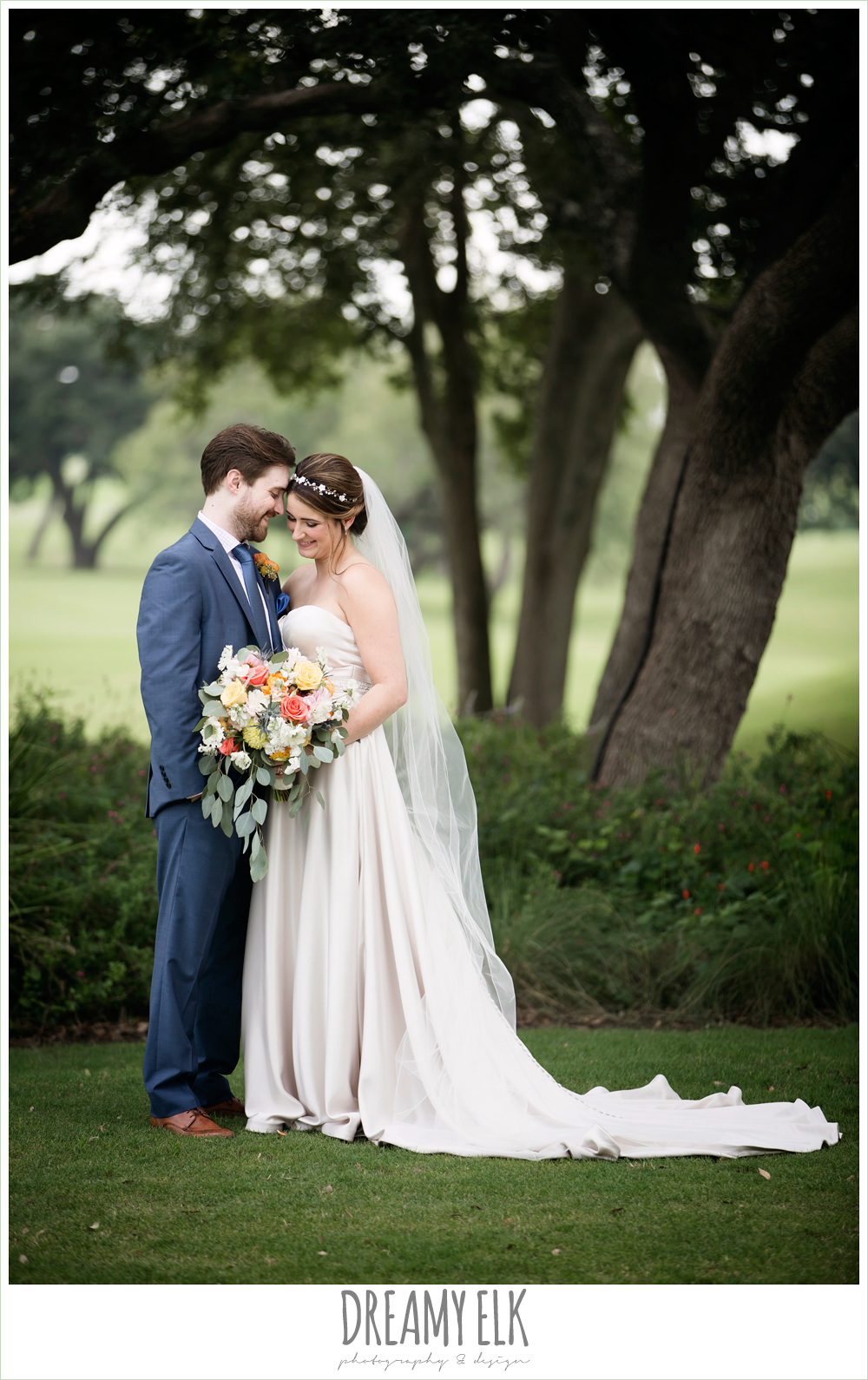 bride and groom portraits, groom in men's wearhouse navy suit pink shirt and navy tie, sweetheart strapless justin alexander wedding dress in sand color, colorful outdoor sunday morning brunch wedding, hyatt hill country club, san antonio wedding photo {dreamy elk photography and design}