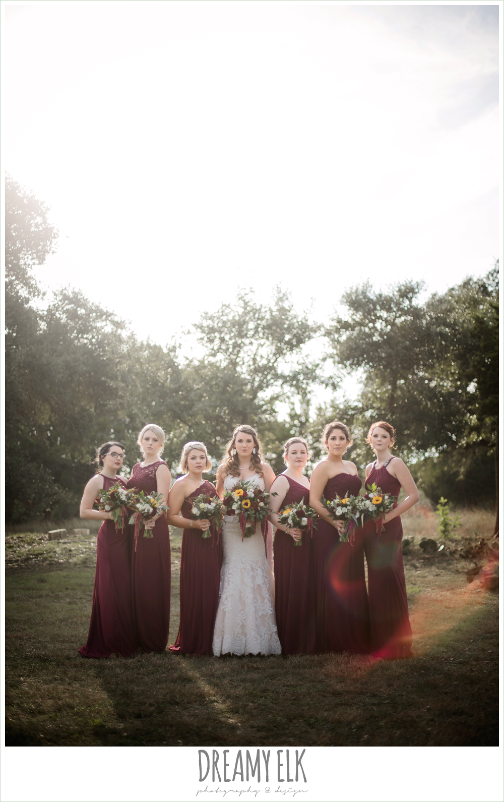 mix and match maroon long chiffon bridesmaid dresses, david's bridal, lustrebella, ventura's bridal fashions, sweetheart lace strapless fit and flare wedding dress, wild bunches floral, bride, bridesmaids, bridal party, maroon and gold fall wedding photo, la hacienda, dripping springs, texas {dreamy elk photography and design}