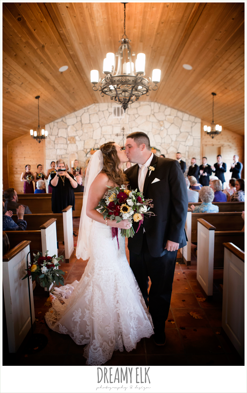men's wearhouse, ventura's bridal fashions, sweetheart lace strapless fit and flare wedding dress, wild bunches floral, bride and groom kissing, walking down the aisle, wedding ceremony, maroon and gold fall wedding photo, la hacienda, dripping springs, texas {dreamy elk photography and design}
