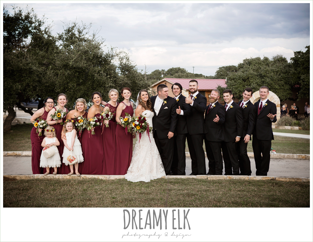mix and match maroon long chiffon bridesmaid dresses, david's bridal, men's wearhouse, ventura's bridal fashions, sweetheart lace strapless fit and flare wedding dress, wild bunches floral, large bridal party, maroon and gold fall wedding photo, la hacienda, dripping springs, texas {dreamy elk photography and design}