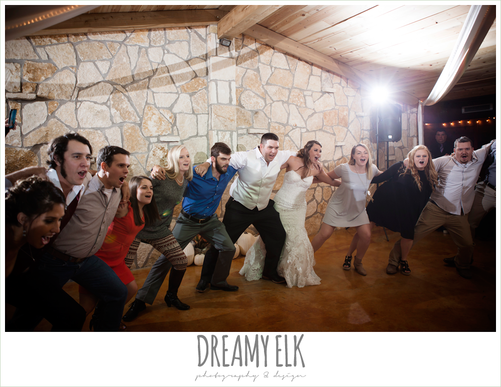 complete weddings dj, aggie war hymn, guests dancing at wedding reception, indoor wedding reception, maroon and gold fall wedding photo, la hacienda, dripping springs, texas {dreamy elk photography and design}