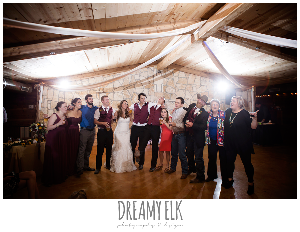 complete weddings dj, guests dancing at wedding reception, indoor wedding reception, maroon and gold fall wedding photo, la hacienda, dripping springs, texas {dreamy elk photography and design}