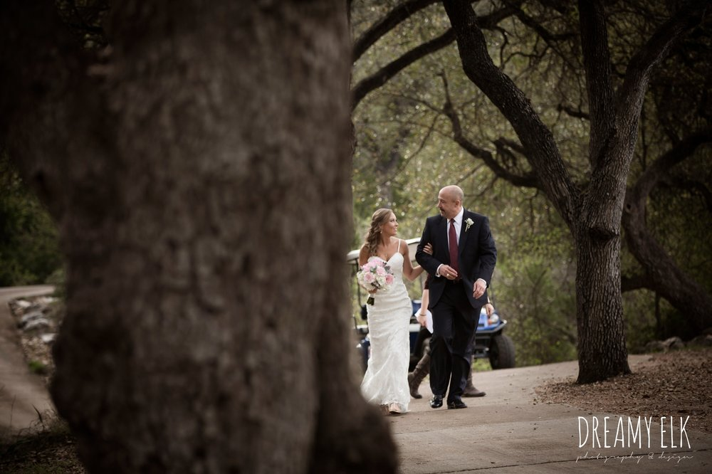father of the bride, dad walking bride down the aisle, backless column sheath wedding dress, cloudy march wedding photo, canyon springs golf club wedding, san antonio, texas {dreamy elk photography and design}