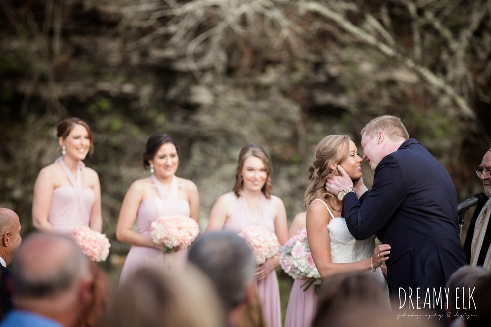 outdoor wedding ceremony, kiss, cloudy march wedding photo, canyon springs golf club wedding, san antonio, texas {dreamy elk photography and design}