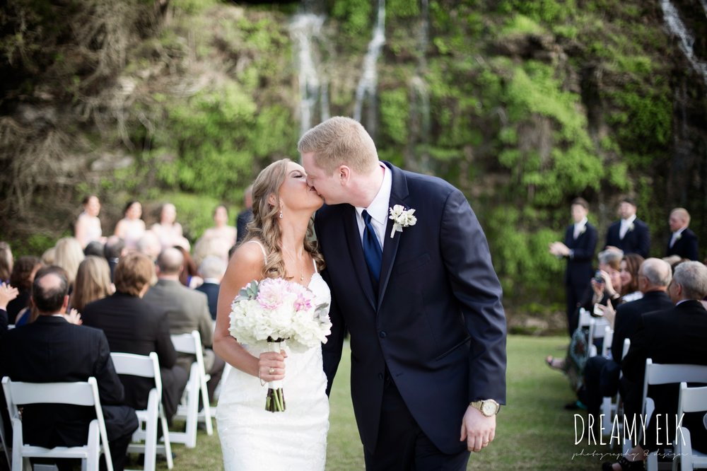 outdoor wedding ceremony, waterfall, bride and groom kissing, cloudy march wedding photo, canyon springs golf club wedding, san antonio, texas {dreamy elk photography and design}