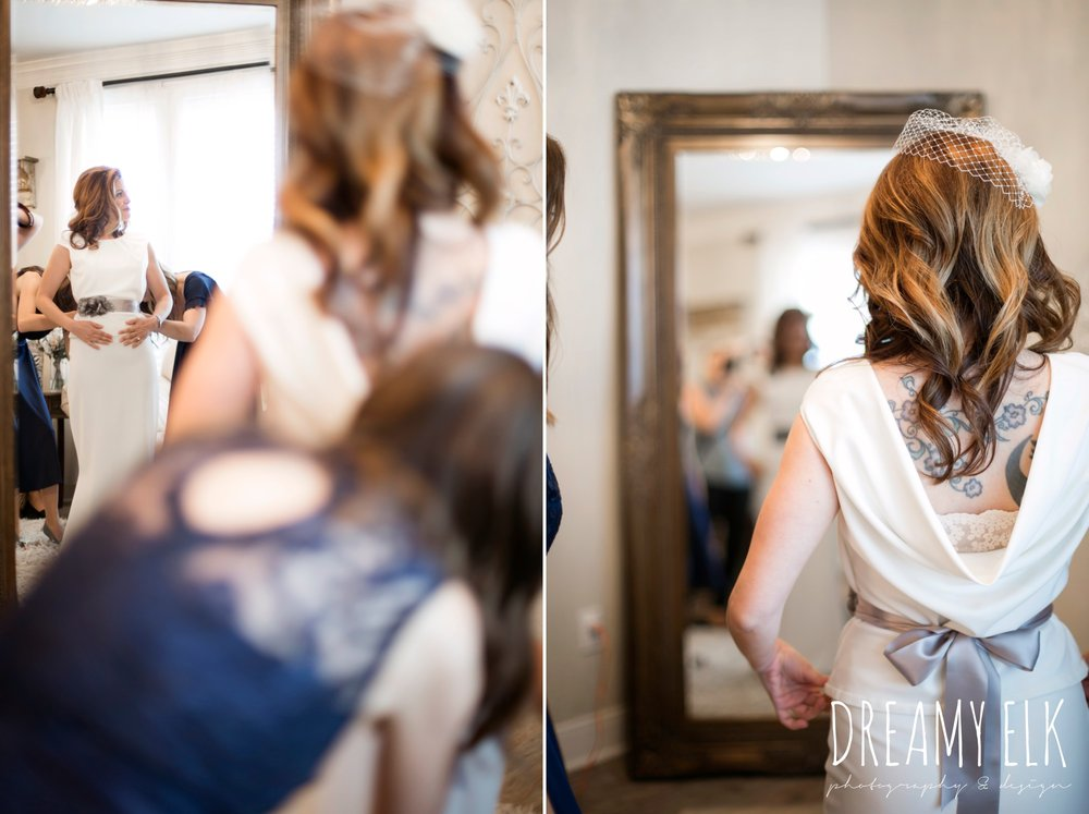 bride getting dressed, handmade wedding dress, two piece wedding dress, gray sash, outdoor april spring wedding photo, double creek crossing, college station, texas, austin wedding photographer {dreamy elk photography and design}