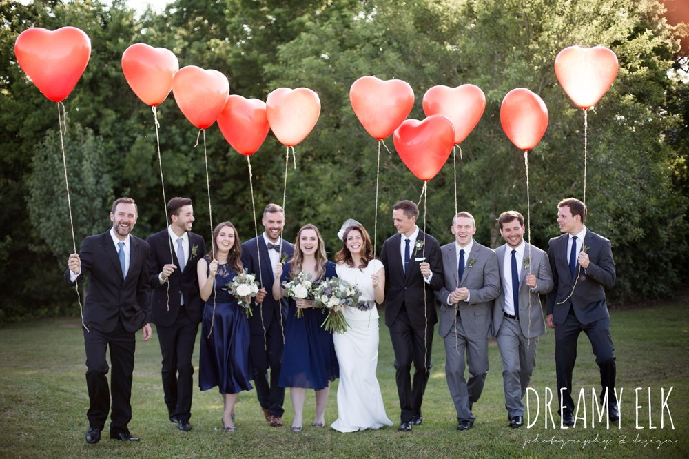 bridal party with red heart balloons, unforgettable floral, white and green succulent wedding bouquet, bride, handmade wedding dress, two piece wedding dress, gray sash, bird cage veil, outdoor april spring wedding photo, double creek crossing, college station, texas, austin wedding photographer {dreamy elk photography and design}