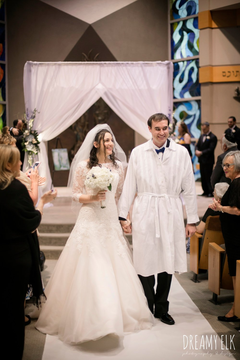 bride and groom walking down the aisle, jewish wedding ceremony, summer june jewish wedding photo {dreamy elk photography and design}