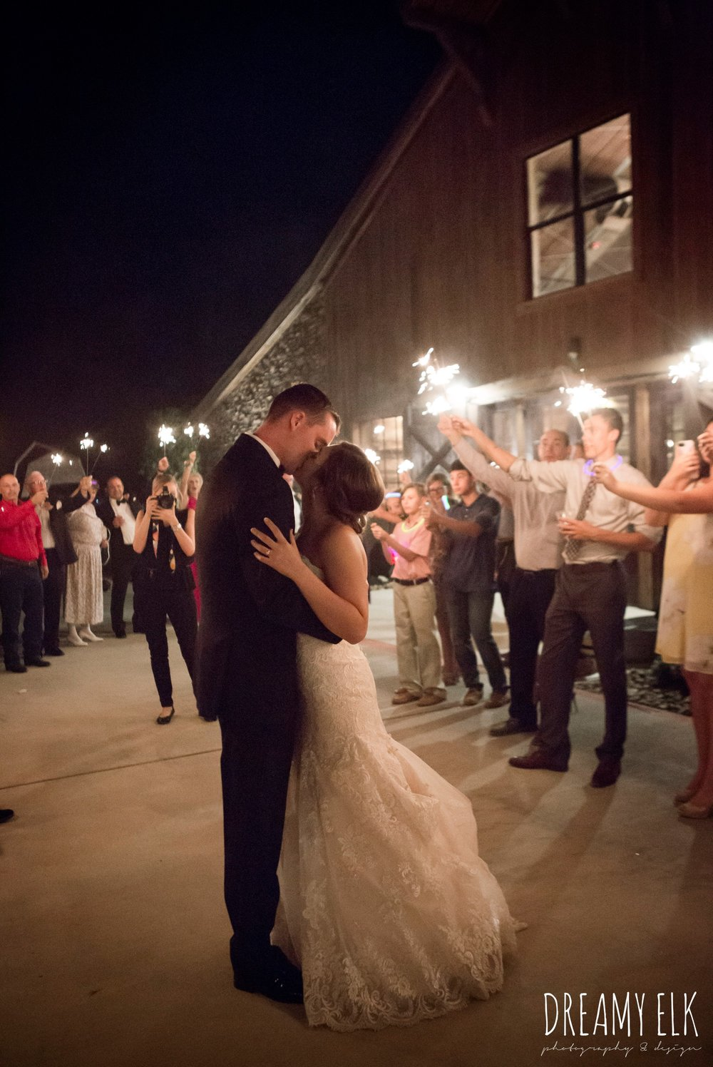 sparkler send off, bride and groom kissing, summer july wedding, lavender, big sky barn, houston, texas, austin wedding photographer {dreamy elk photography and design} photo