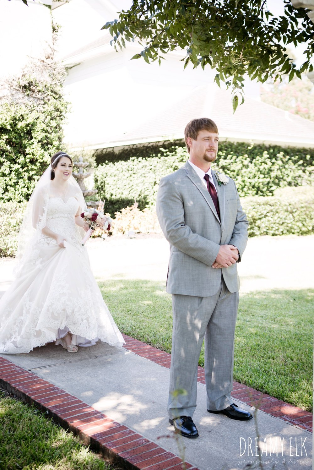 first look, bride, sweetheart lace ballgown wedding dress, oyester underlay, lace trimmed veil, rhinestone headpiece, groom, men's wearhouse gray tux with maroon vest and tie, september wedding photo, ashelynn manor, magnolia, texas, austin texas wedding photographer {dreamy elk photography and design}