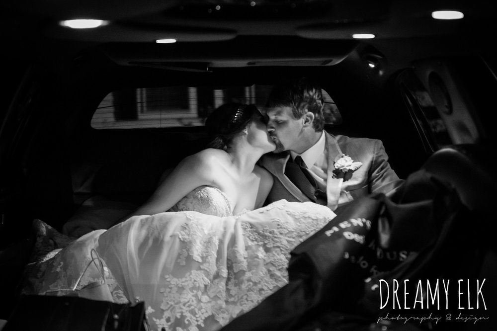 bride and groom kissing in limo, september wedding photo, ashelynn manor, magnolia, texas, austin texas wedding photographer {dreamy elk photography and design}