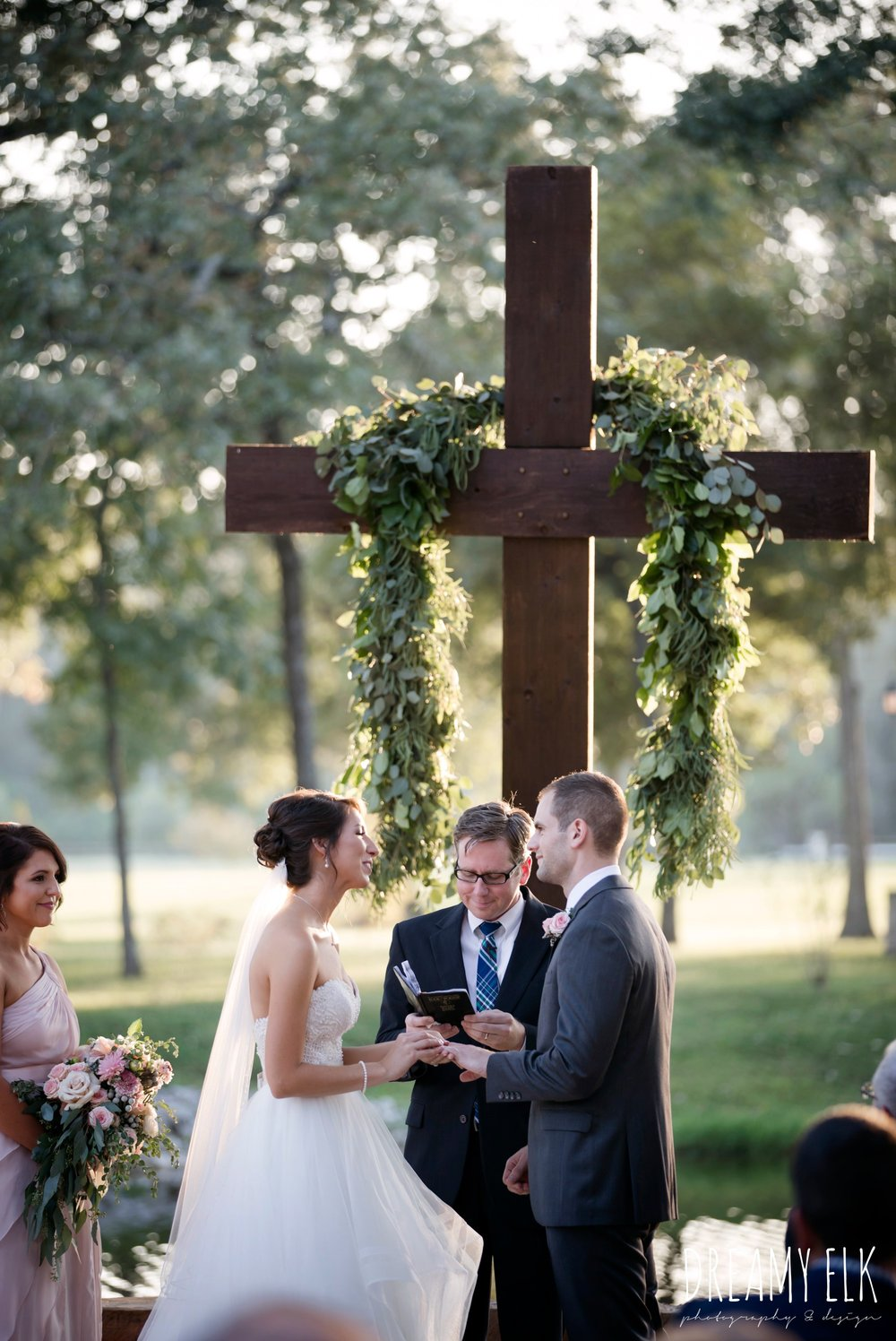 sunset wedding ceremony, bride and groom exchanging rings, outdoor fall october wedding photo, blush and gray wedding, balmorhea weddings and events, dreamy elk photography and design, austin texas wedding photographer