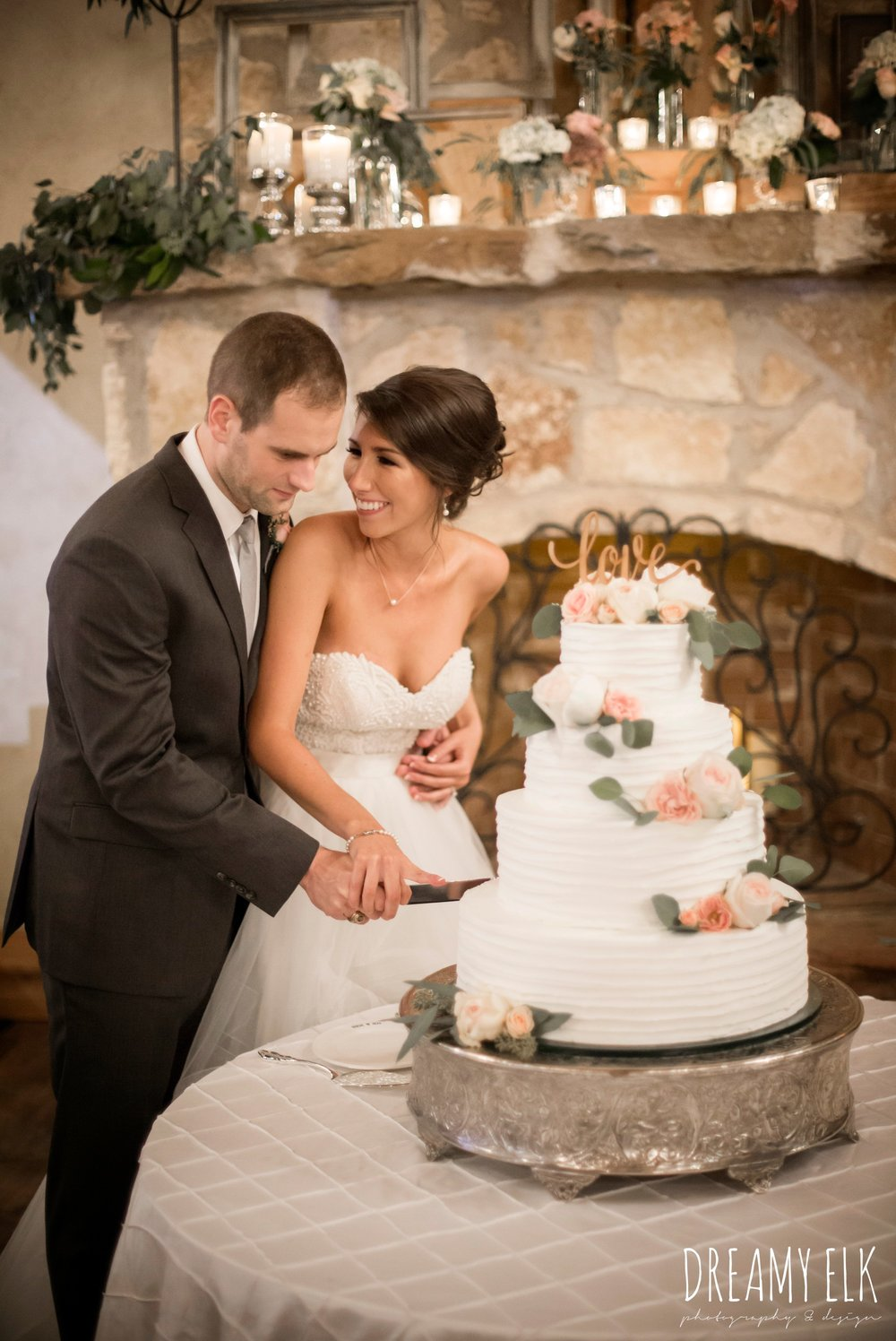 bride and groom cutting the cake, four tier wedding cake with flowers, love cake topper, outdoor fall october wedding photo, blush and gray wedding, balmorhea weddings and events, dreamy elk photography and design, austin texas wedding photographer