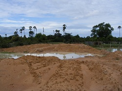 Land at Kampong Chhnang beginning to be filled. The onset of the wet season has stopped work.