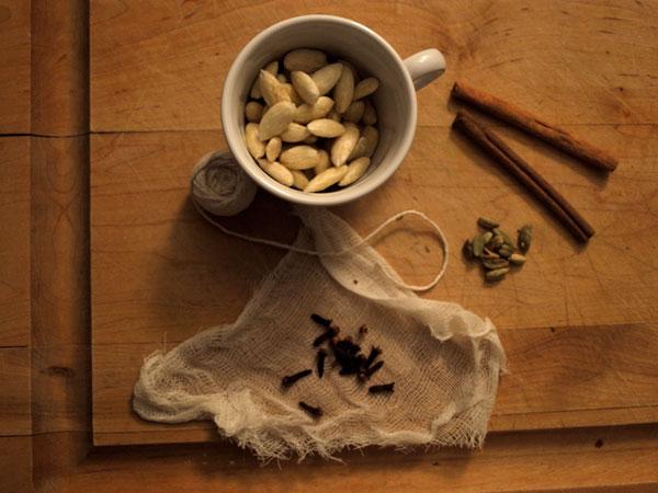 Making glögg! (Mulled wine, with cinnamon, cloves, cardamom, raisins, almonds, orange peel…) Yum.