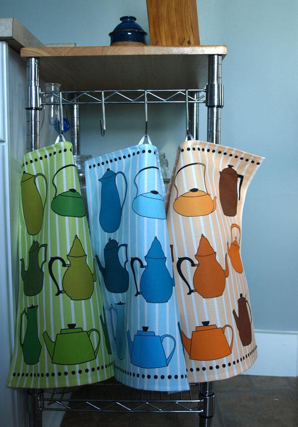Three colorways in my teapot tea towel design, Green Tea, Early Grey and Peach Tea.