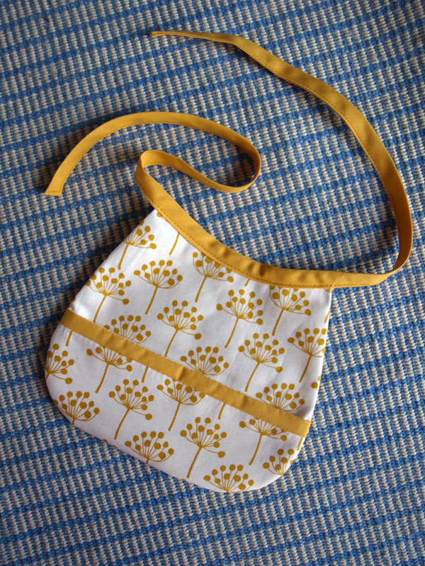 New bib design available on  etsy ! Again with that great fabric from Lotta Jansdotter.