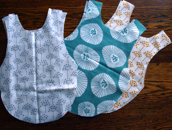 And here's what I ought to be doing today. Baby smocks!   … with fabric buttons to match? I think so.