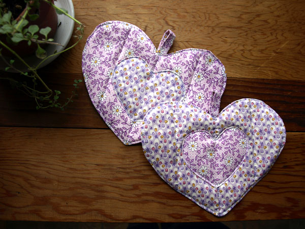 Just finished three sets of heart shaped pot holders, purple vintage 1940s fabric