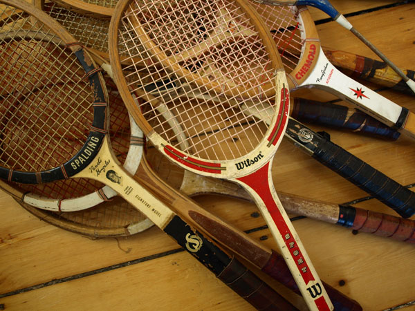 My mom was getting rid of these old rackets. So we took one. Then we took two. And then I went back inside and grabbed them all.