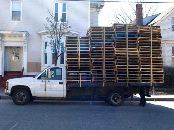 There are usually two of these trucks, pallets stacked high. Happy I finally had my camera to get one of them.